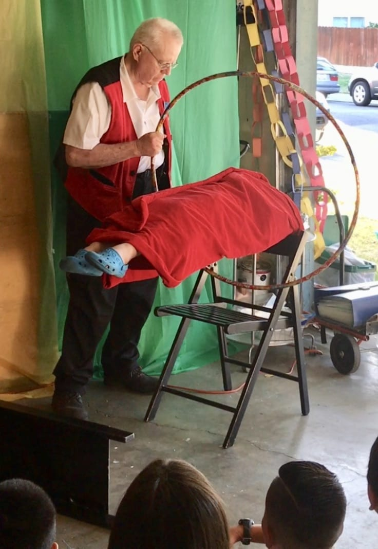 sacramento magician performs levitation